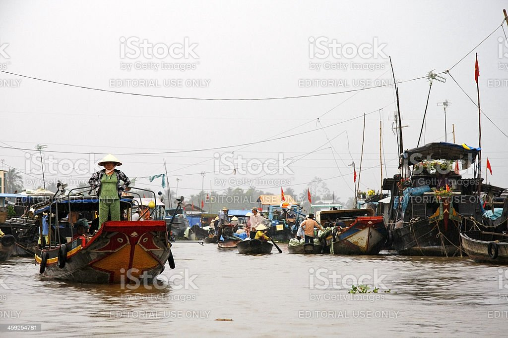 Vietnamese woman standing on a boat royalty-free stock photo