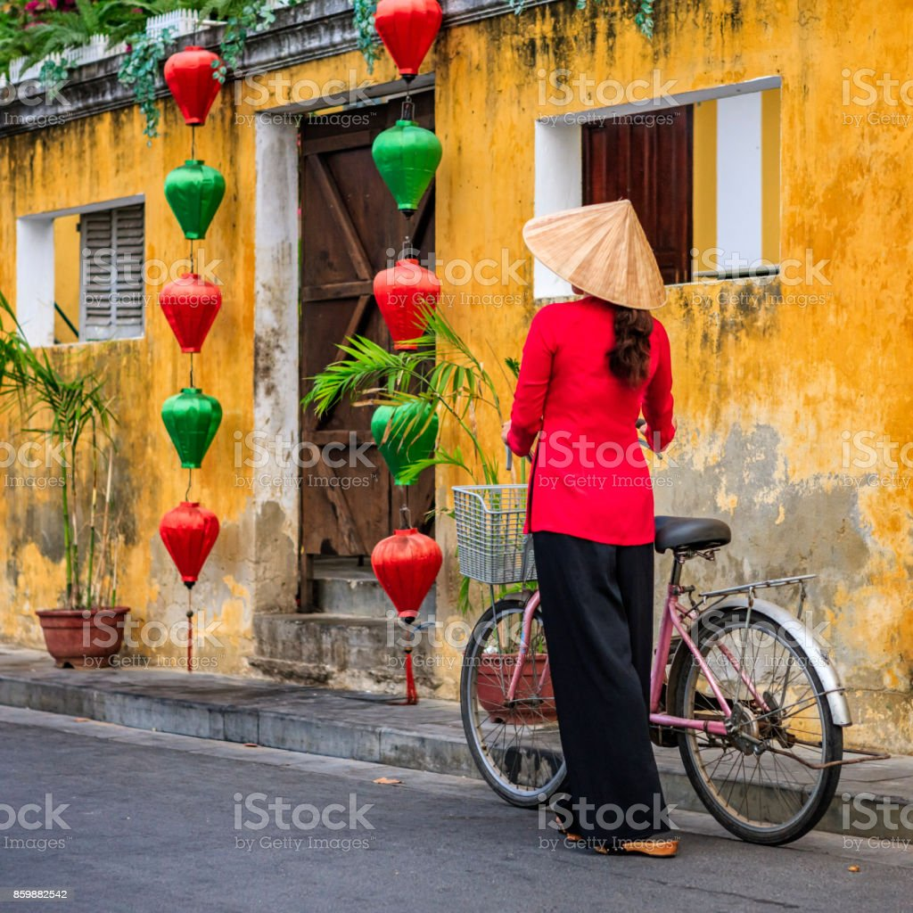 Vietnamese woman with a bicycle, old town in Hoi An city, Vietnam stock photo