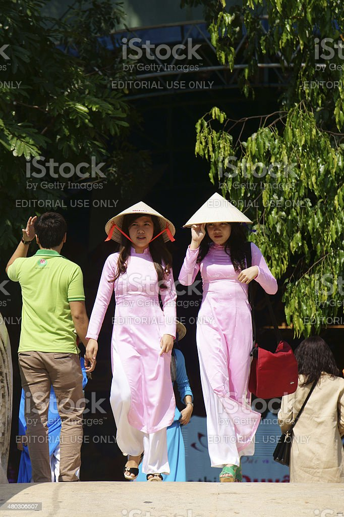 Vietnamese young girl in  traditional dress stock photo