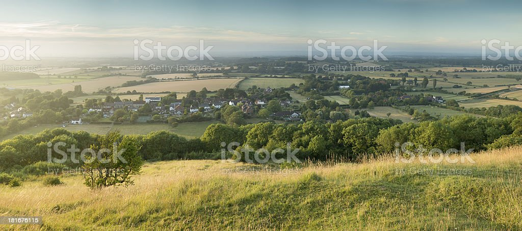 View across English countryside landscape during late Summer evening royalty-free stock photo