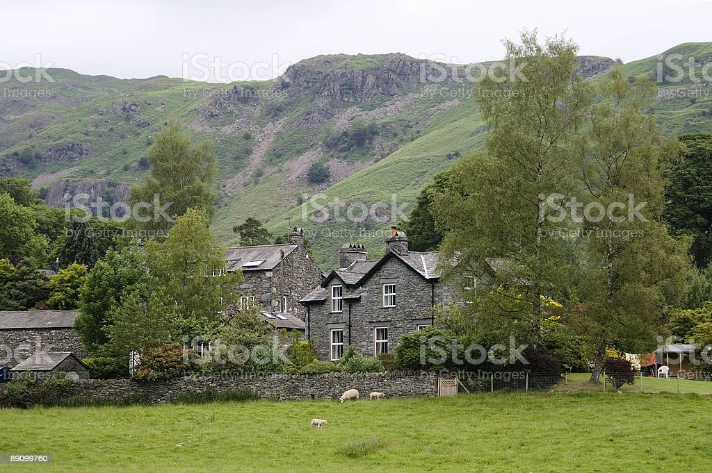 View across meadow to cottages at Elterwater royalty-free stock photo