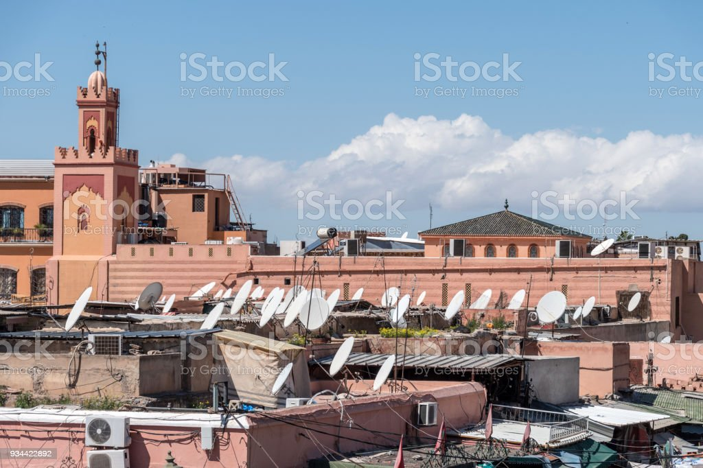 View across rooftops of Marrakesh in Morocco with mosque stock photo