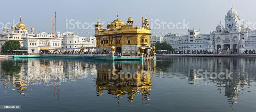 View across shimmering water of Golden Temple, Amritsar stock photo