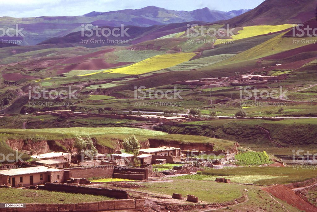 View across small village to rural landscape of the Loess Plateau Inner Mongolia China stock photo