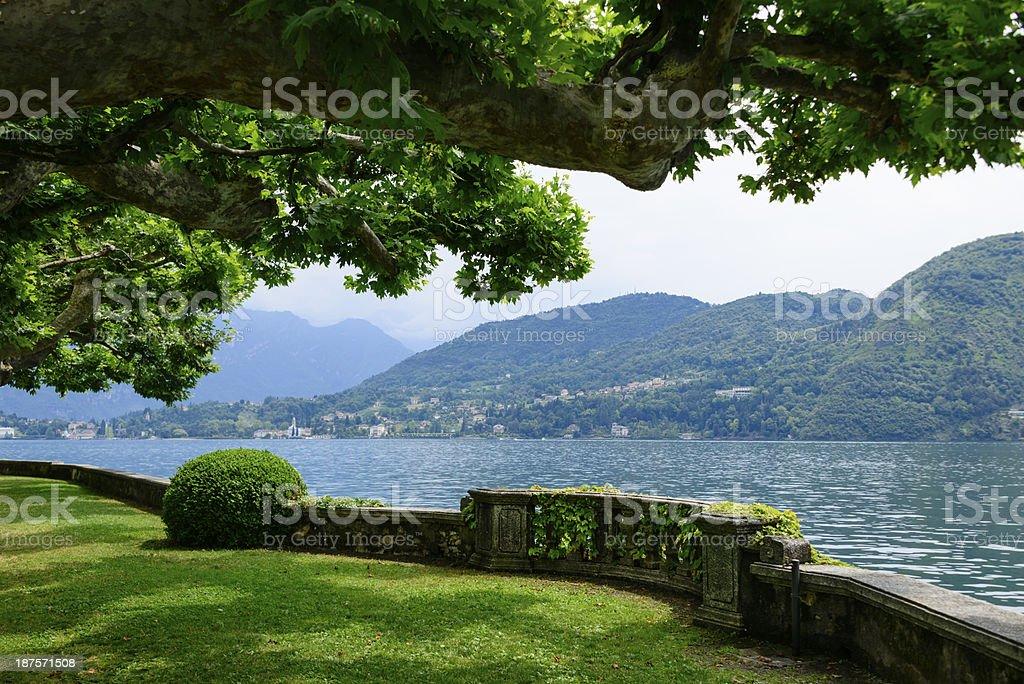 View across stone fence of beautiful lake -XXXL stock photo