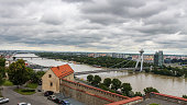 Bratislava, Slovakia - July 5th 2018: A view across the River Danube, Most SNP Bridge, and Ovsiste from Bratislava Castle, Bratislava, Slovakia