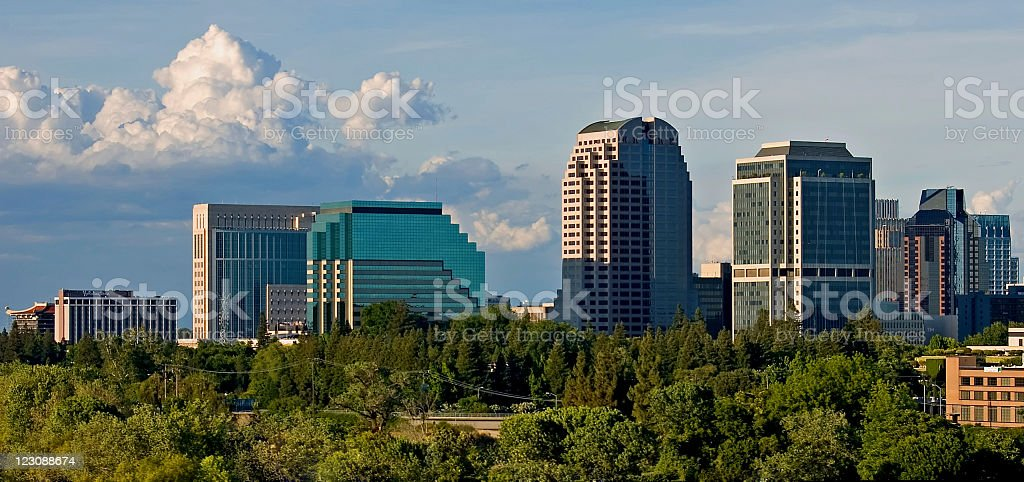 A view across trees of skyscrapers in Sacramento royalty-free stock photo