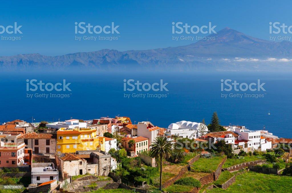 View Agulo town buildings banana plantation Tenerife island Teide volcano background, La Gomera, Canary Islands stock photo