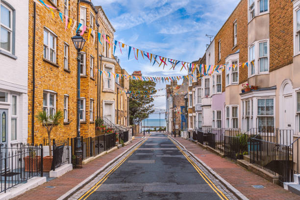A view along Addington Street, Ramsgate toward the sea. Bunting is flying in preparation for the annual street fair. The street is part of Ramsgate's burgeoning music and art scene. stock photo