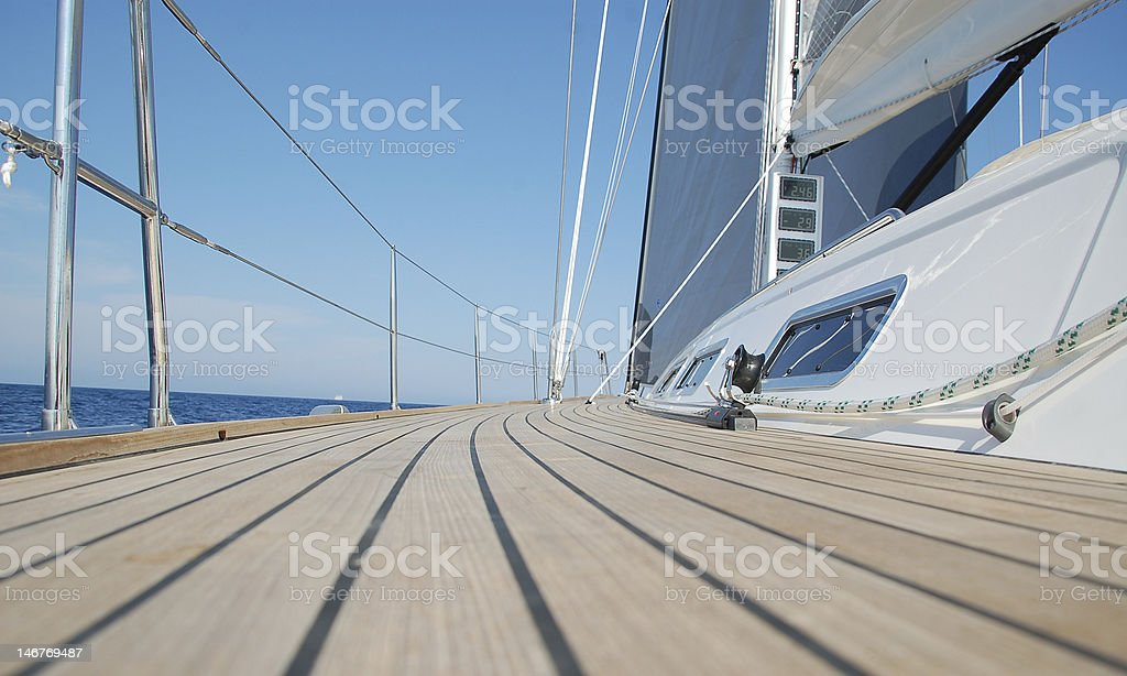 View along teak deck on a sailboat stock photo