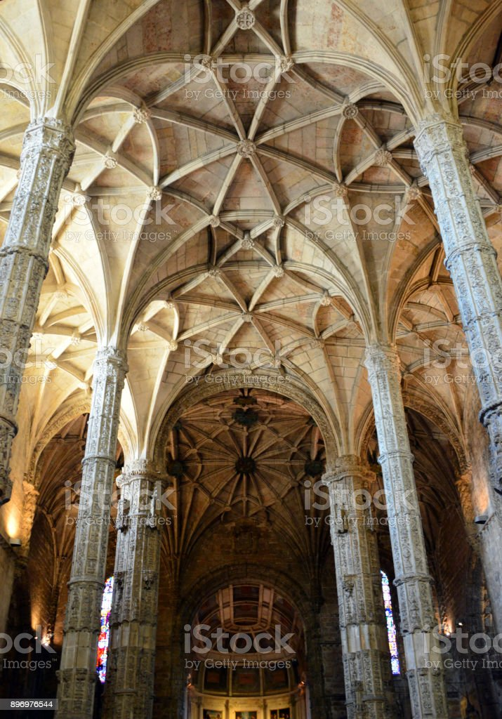View along the nave of the Jeronimos monastery church ribbed vault ceiling, Lisbon, Portugal stock photo