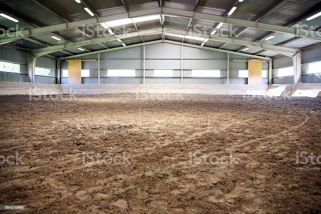 View an indoor riding arena backlight for dressage horses stock photo