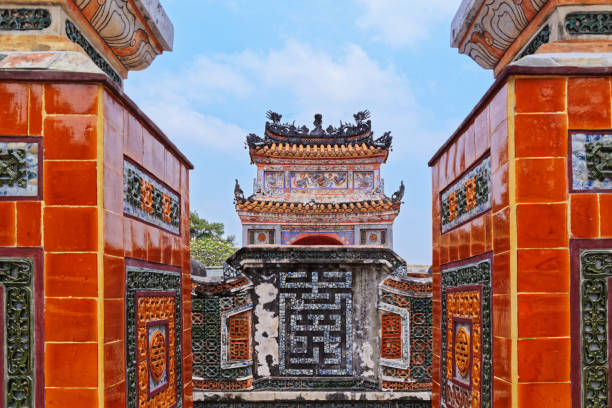 View at a mosaic spirit screen through exit from a grave. Tu Duc royal tomb in Hue, Vietnam stock photo