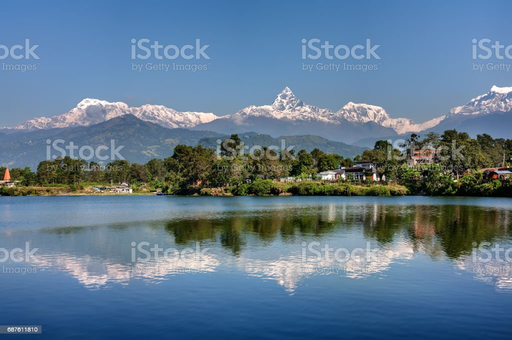 View at Annapurna mountain range and its reflection in Phewa lake in Pokhara, Nepal stock photo