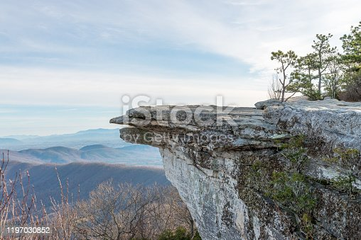 Telephoto overlook of a McAfee Knob and Blue Ridge mountains in Virginia, USA, on sunrise in autumn