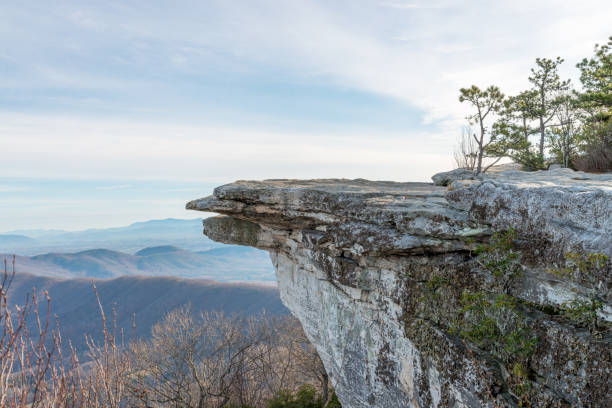 View at autumn Appalachian mountains Telephoto overlook of a McAfee Knob and Blue Ridge mountains in Virginia, USA, on sunrise in autumn cliffs stock pictures, royalty-free photos & images