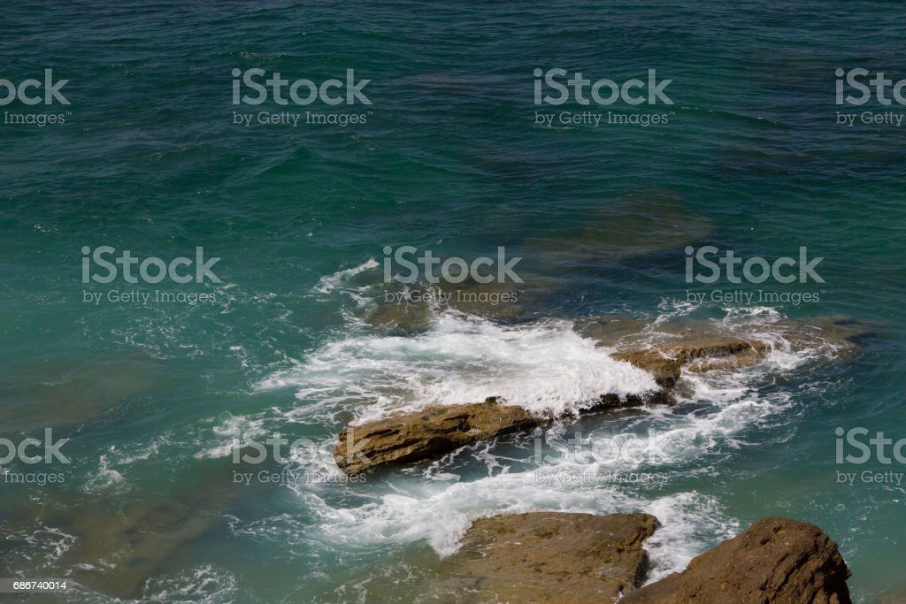 View at Cape Trafalgrar turquoise sea ocean white foam stock photo