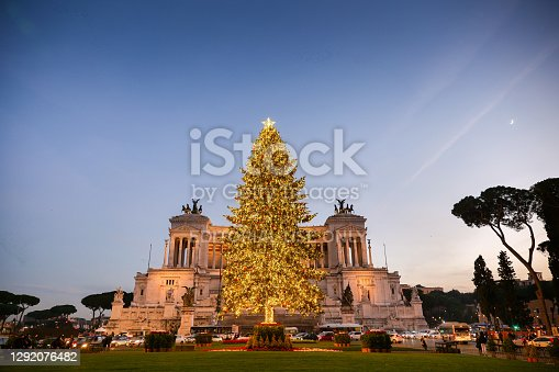 Rome, Italy, December 18 - A view at dusk of the Christmas tree in Piazza Venezia, in the heart of Rome. In background the Vittoriano or Altare della Patria, the Italian National Memorial monument dedicated to died soldiers and the fist king of Italy, Vittorio Emanuele II, built in the 1920s after Italy's victory in the First World War. Image in High Definition format.