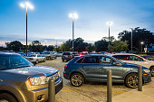 New Orleans, USA - Dec 14, 2017: View at dusk of the parking area of a shopping center in the suburb of Lakeview.