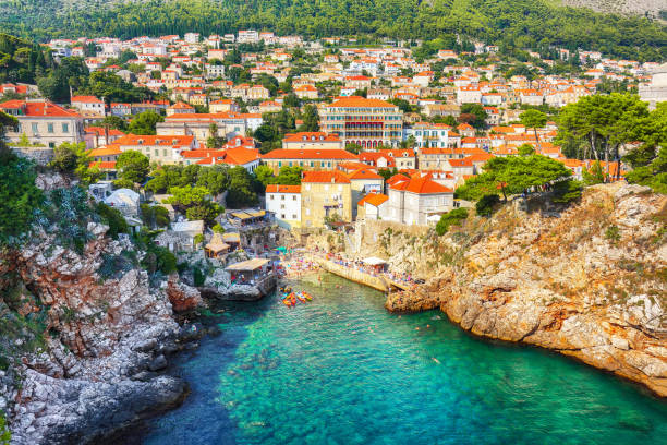 View at famous travel destination city of Dubrovnik - Fort Bokar and Fort Lovrijenac on a sunny day stock photo