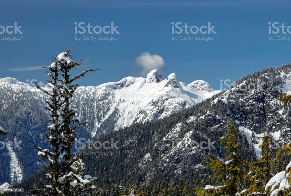 View at  Lions Peaks from Grouse Mountain stock photo
