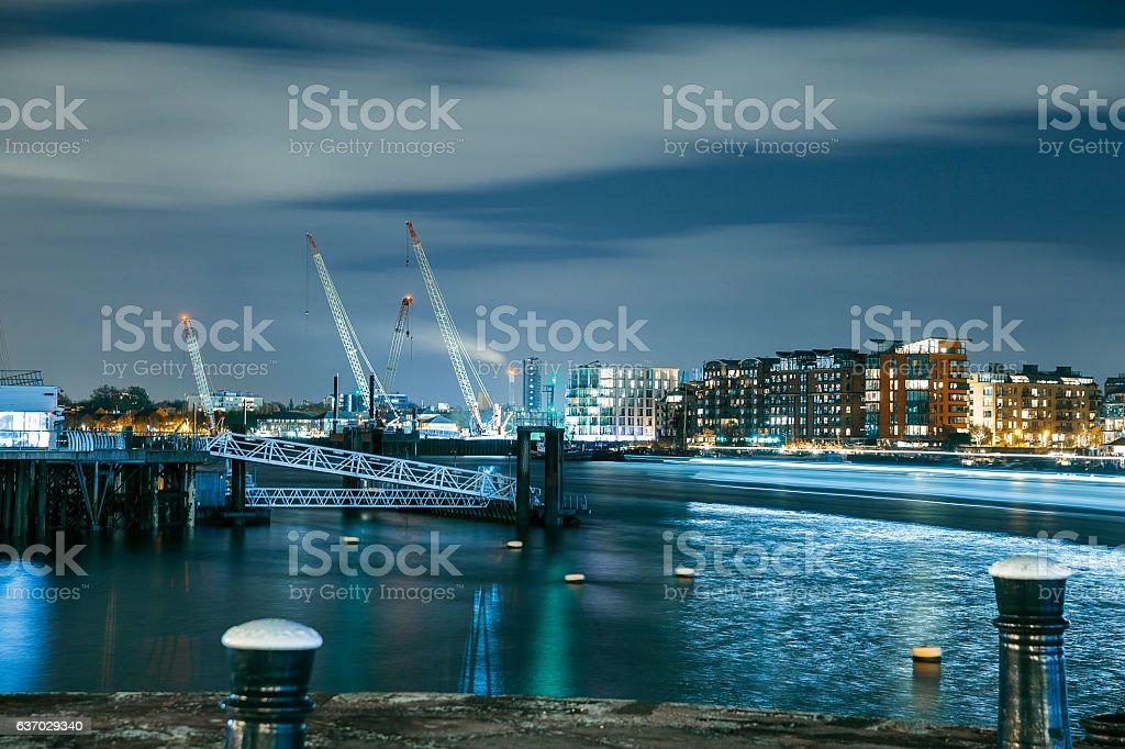 View at night dock and illuminated city stock photo