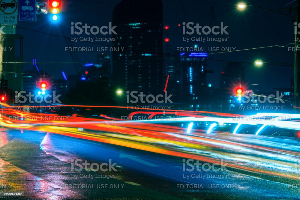 View at night of traffic on the road at West End in Brisbane on Saturday 14th October 2017. stock photo
