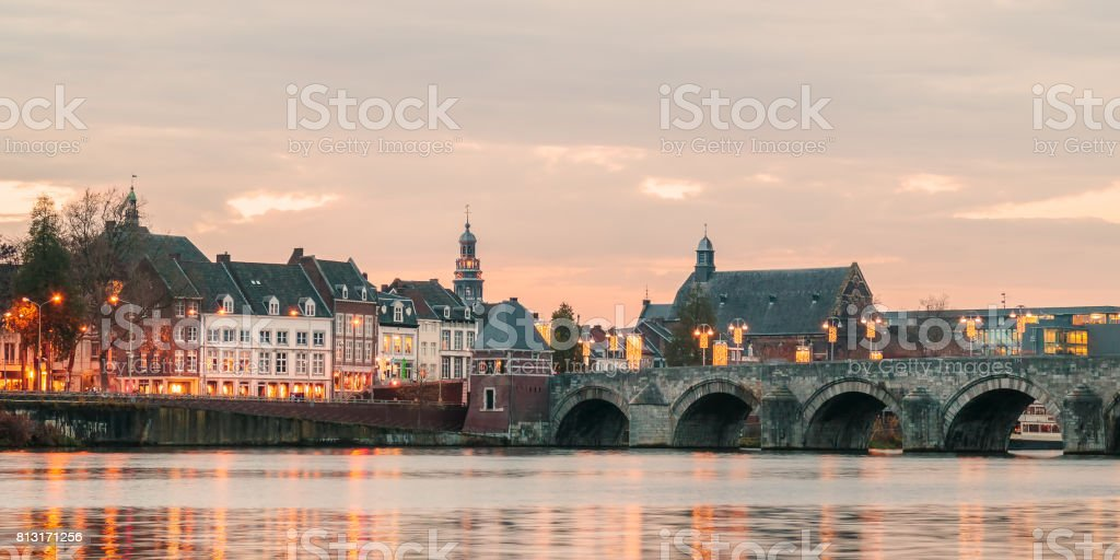 View at the Dutch Sint Servaas bridge with lights in Maastricht stock photo