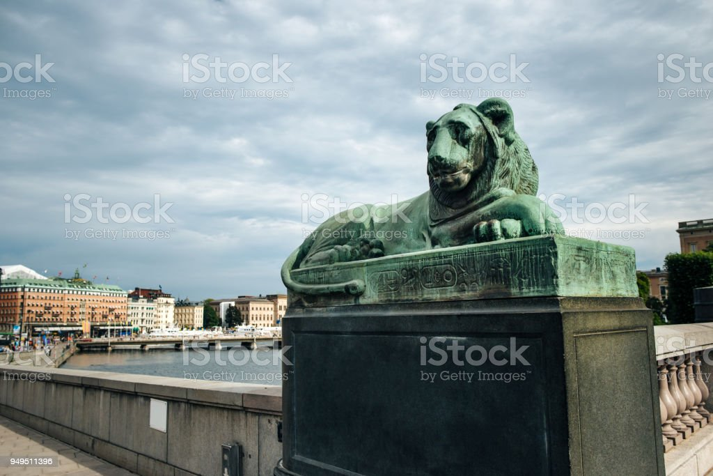View at the the North Bridge bronze lion statue in the Old Town of Stockholm. stock photo