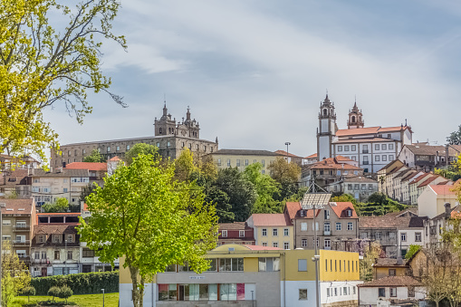Viseu / Portugal - 04 16 2019 : View at the Viseu city, with Cathedral of Viseu and Church of Mercy on top, Sé Catedral de Viseu e Igreja da Misericordia, monuments of various classical styles, architectural icons of the city of Viseu, Portugal