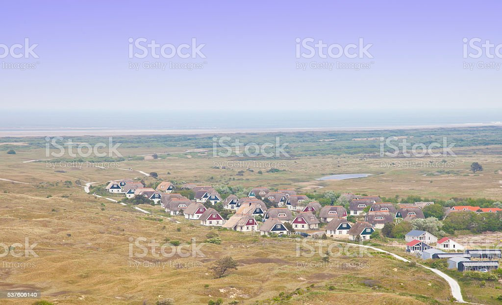 View at typical Dutch houses on island Ameland, The Netherlands stock photo