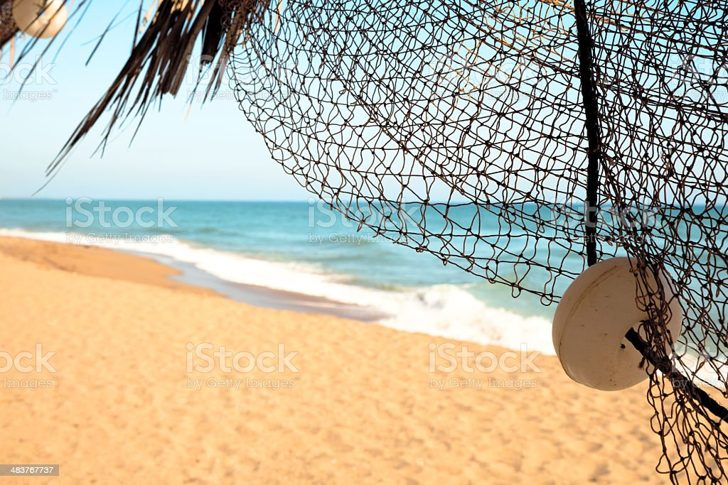 View behind Fishermen's net to sun and sea royalty-free stock photo
