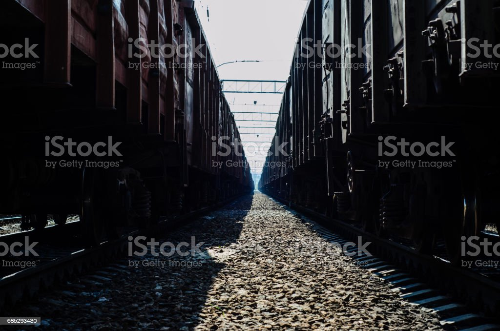 View between two cargo trains on a cloudy day stock photo