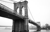 View Brooklyn Bridge with Foggy City in the Background in Black and White