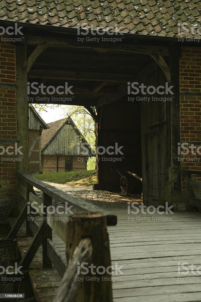 View by a gatehouse on the old farm house stock photo