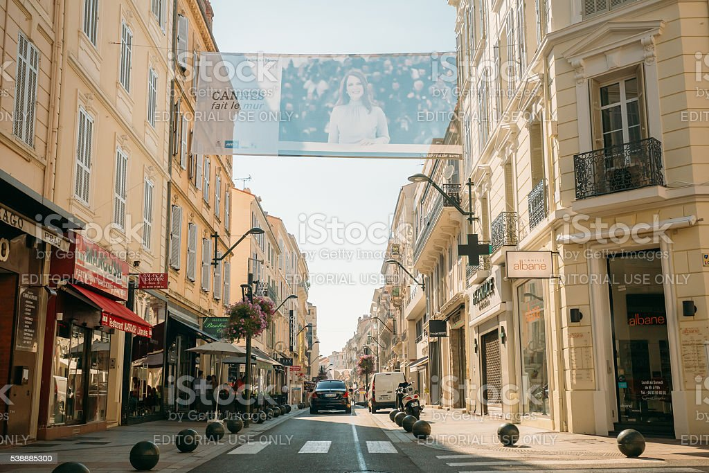 View city street with parking restrictions balls barriers, Cannes, France stock photo
