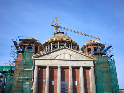 View construction new church building in Kazan city, crane, scaffold, sky background