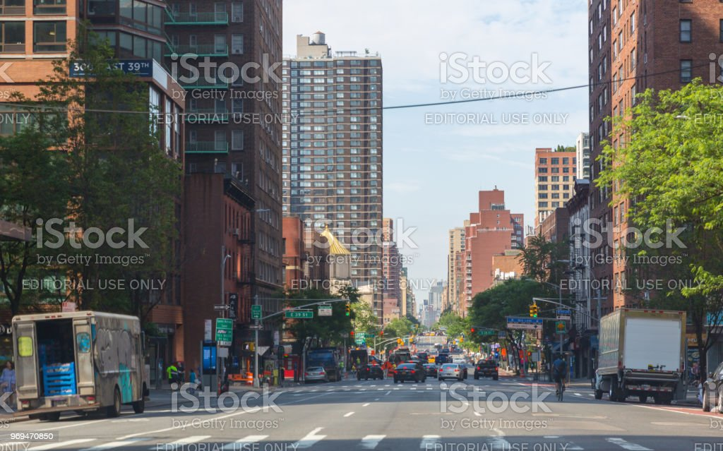 A view down a busy avenue street, People walk on busy streets