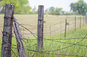 istock View down a country barbed wire fence 1093249766