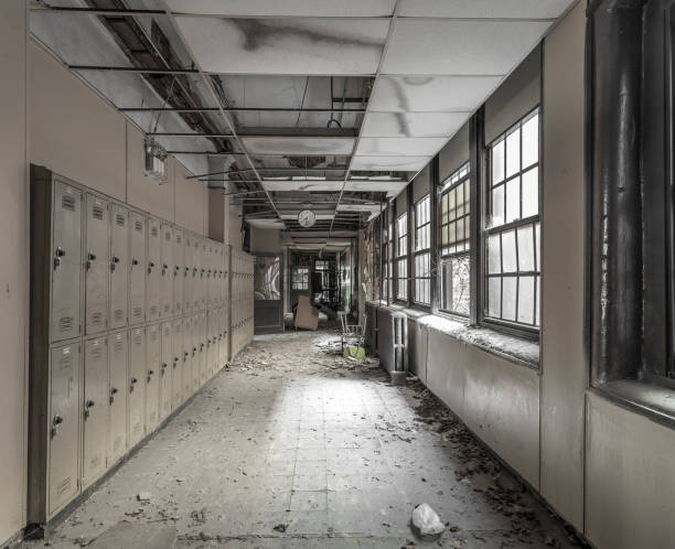 view down a hallway in an abandoned high school - abandoned stock photos and pictures