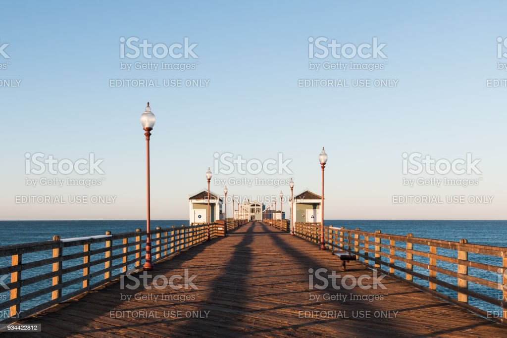 View Down Empty Oceanside Fishing Pier in the Morning stock photo