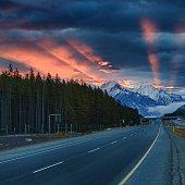 Sun rays illuminate the sky, Banff National Park, Canadian Rockies, Alberta