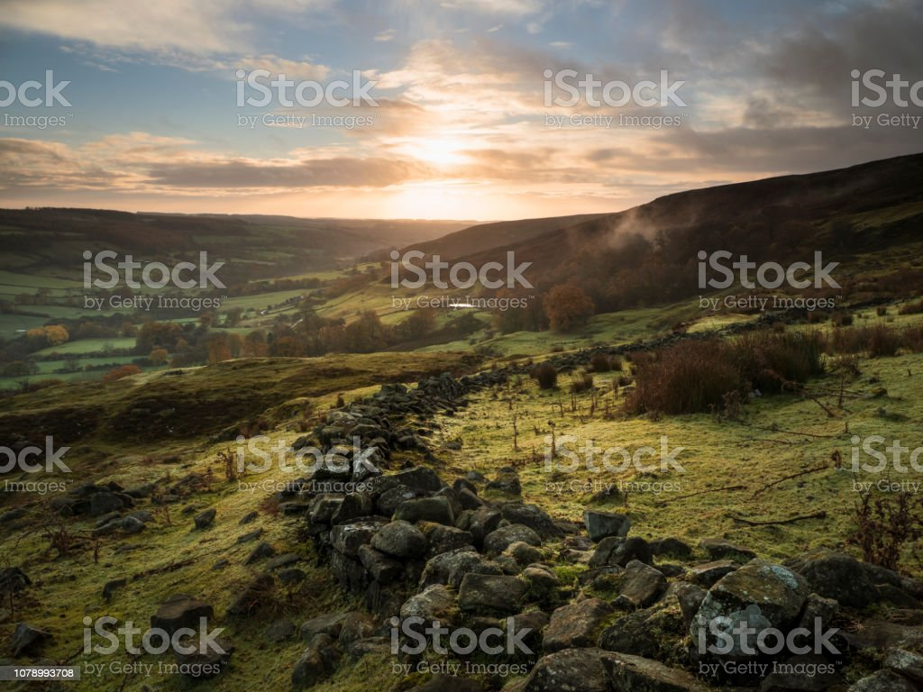 A view down into Rosedale along an old stone wall. stock photo