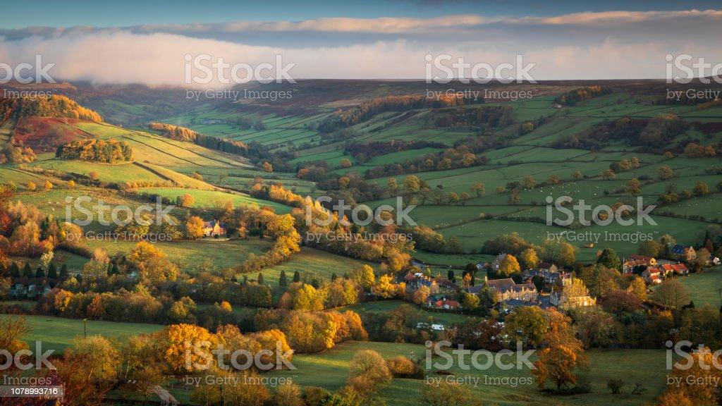 A view down into Rosedale to the village of Rosedale Abbey in Autumn. stock photo