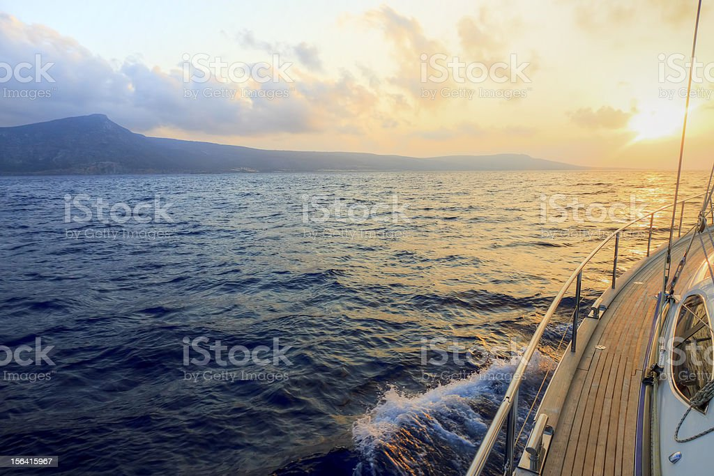 View from a boat at sea at sunset royalty-free stock photo