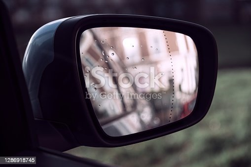 View from a driver's side mirror of a terrace of Victorian housing (out of focus).  Belfast, Northern Ireland.
