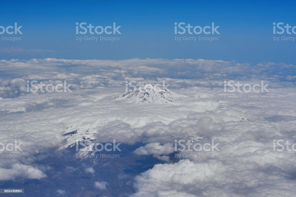view from a height to the snowy peaks of the mountains stock photo