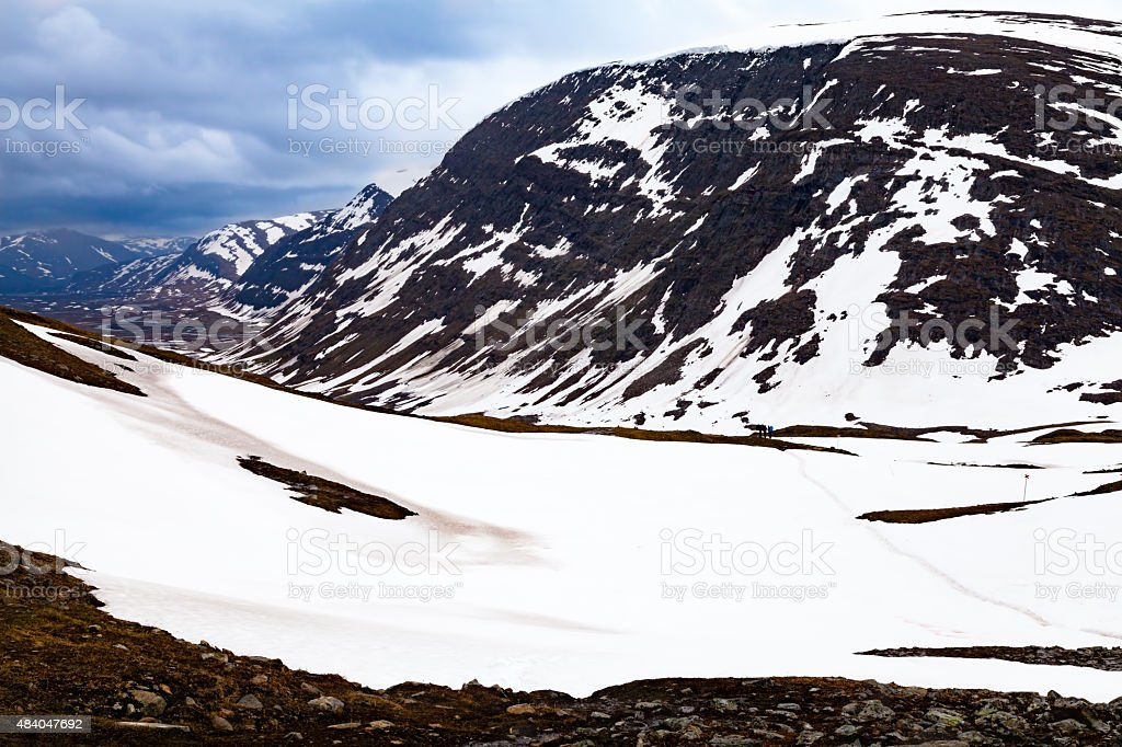 View from a mountain passage, tourists, snow stock photo
