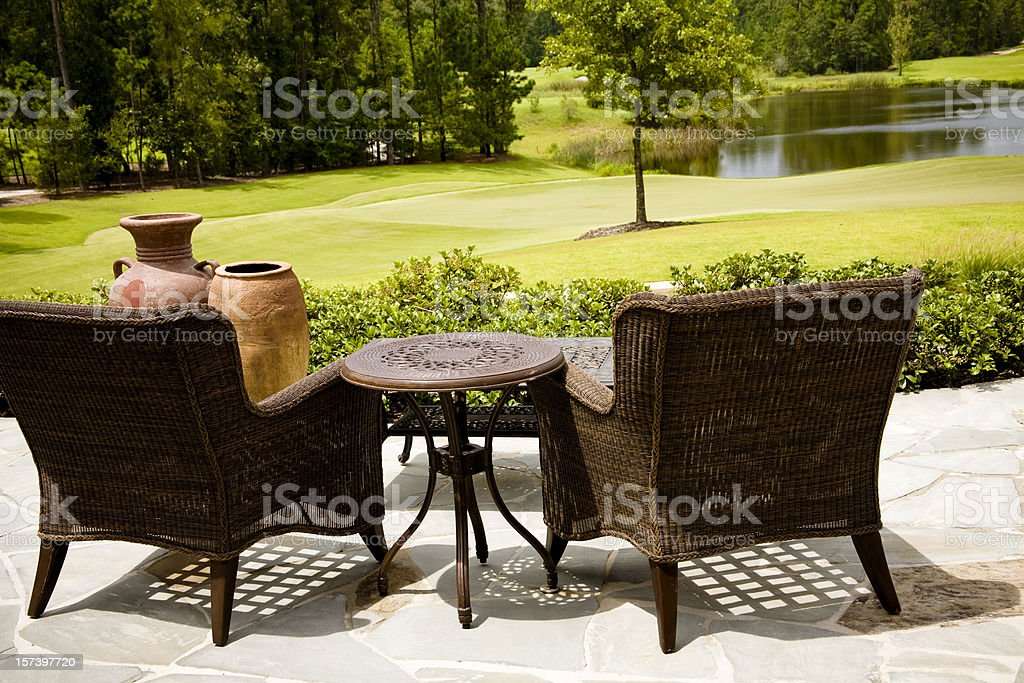View from a patio of pond, lawn and golf course. royalty-free stock photo