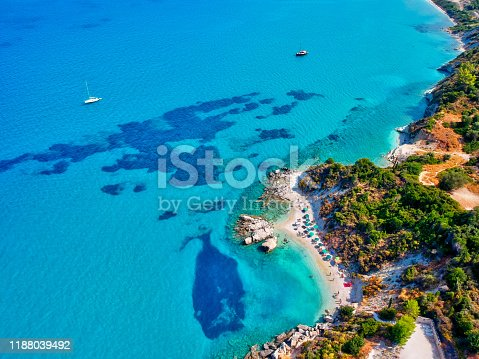 istock View from above, aerial view of a beautiful tropical beach with white sand and turquoise clear water. 1188039492